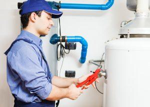 bigstock-Plumber-repairing-an-hot-water-40728454.jpg